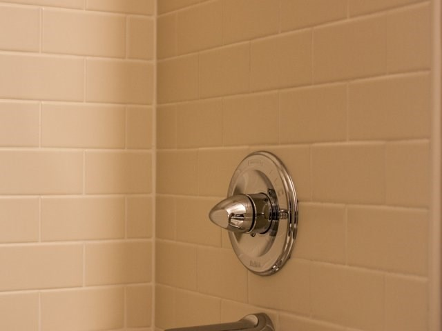 Ceramic tile surounds highlight the showers