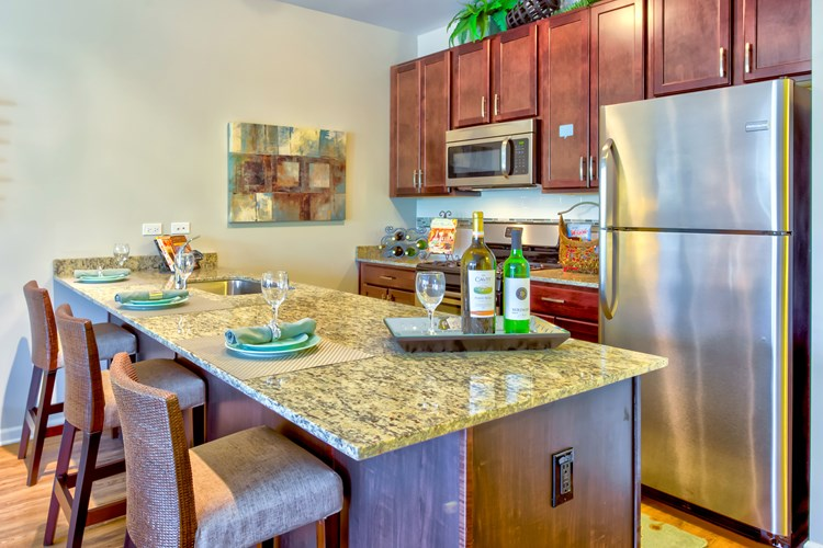 Gourmet Kitchens with Eat-in Islands & Stainless Steel Appliances