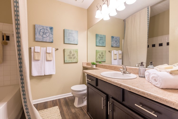 Upgraded Bathrooms Feature Wood Flooring