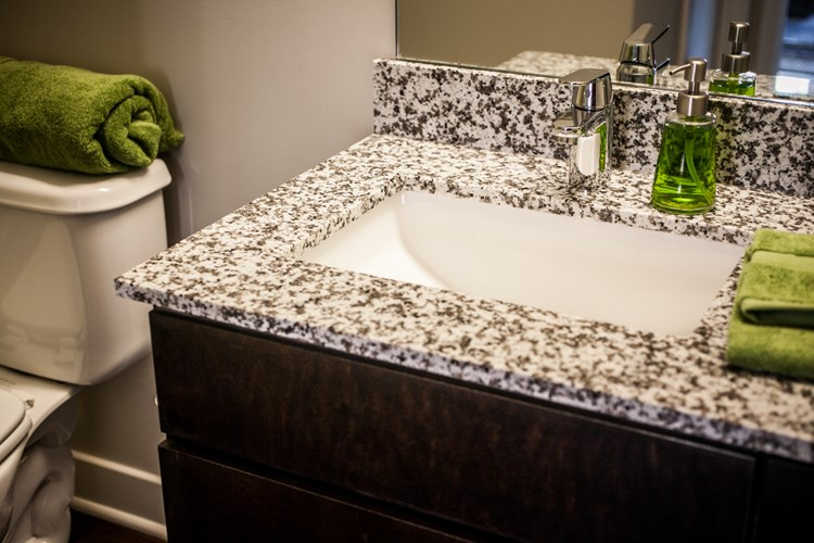 Mozzo's showcase bathrooms offer granite countertops with sleek undermount sinks and modern fixtures
